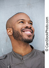 Portrait of a happy young african american man smiling