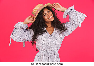 Portrait of a happy young african woman in summer dress