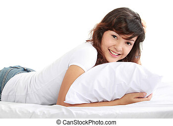 young asian woman lying on the bed