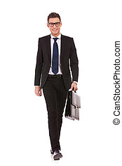 young business man carrying a suitcase, walking