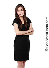 Portrait of a happy young business woman standing with folded ha