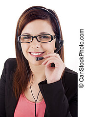 Portrait of a happy young call centre employee smiling with a headset over white
