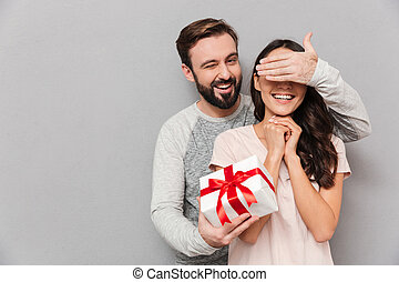 Portrait of a happy young couple hugging