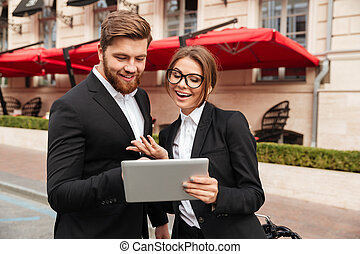 Portrait of a happy young couple in smart clothes