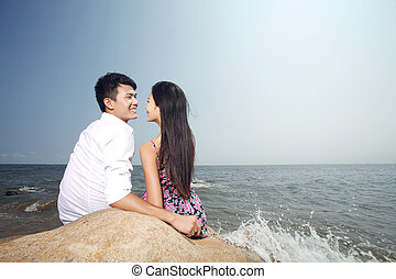 Portrait of A happy young Couple on seaside
