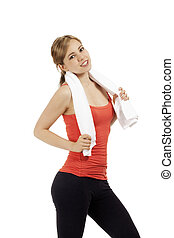portrait of a happy young fitness woman with a white towel on white background