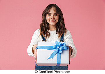 Portrait of a happy young girl giving present box