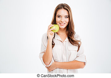 Portrait of a happy young girl holding green apple