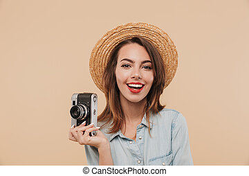 Portrait of a happy young girl holding photo camera