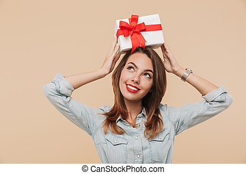 Portrait of a happy young girl holding present box