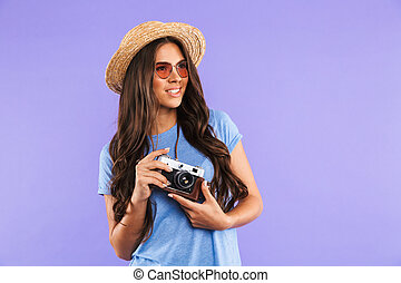 Portrait of a happy young girl in hat and sunglasses