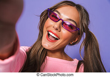 Portrait of a happy young girl in sunglasses