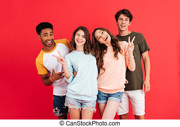 Portrait of a happy young group of multiracial friends