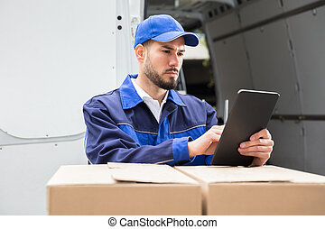 Male Worker Using Tablet