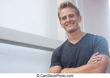Portrait of a happy young man looking at camera