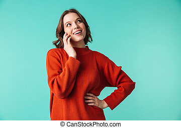 Portrait of a happy young woman dressed in sweater