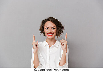 Portrait of a happy young woman dressed in white shirt
