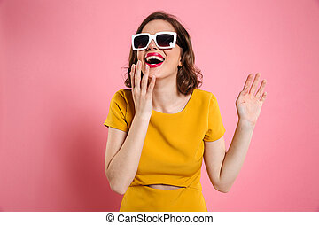 Portrait of a happy young woman in sunglasses