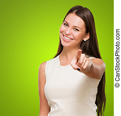 Portrait Of A Happy Young Woman Pointing At You