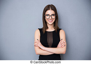 Portrait of a happy young woman with arms folded