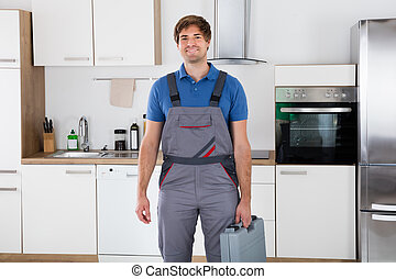 Happy Young Worker Holding Toolbox