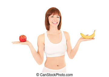 Portrait of a healthy young woman with apple and banana