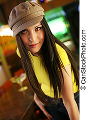 Portrait of a hip beautiful young woman in cap hat. Shallow DOF.