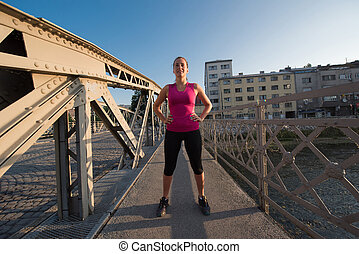 portrait of a jogging woman at sunny morning