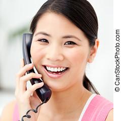 Portrait of a jolly businesswoman talking on phone