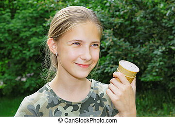 Portrait of a joyful teenage girl with ice cream in her hand