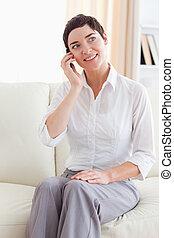 Portrait of a Joyful woman with a cellphone