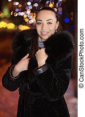 Portrait of a joyful young brunette