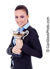 female entrepreneur holding a trophy