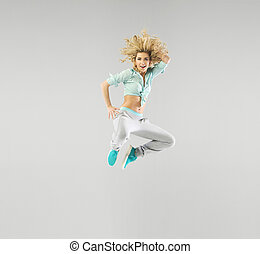 Portrait of a jumping blond athlete