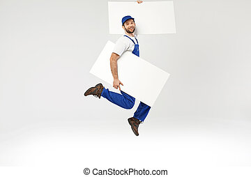 Portrait of a jumping builder