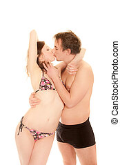 Portrait of a kissing young couple in swim-wear