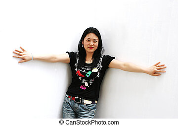 Portrait of a Korean woman in jeans and a t-shirt