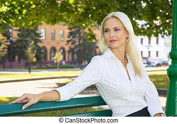 Portrait of a lady on a bench