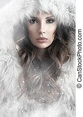 Portrait of a lady winter wearing a fur coat