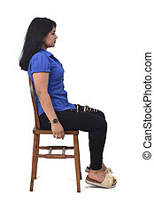 portrait of a latin woman sitting on a chair in white background, profile