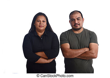 portrait of a latinamerica couple with arms crossed on white