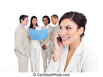 Portrait of a laughing businesswoman on phone with her team