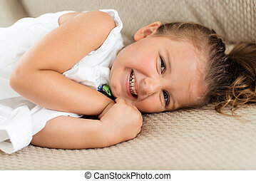 laughing little girl lying down