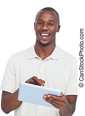 Portrait of a laughing man with tablet pc