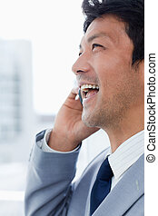 Portrait of a laughing office worker on the phone
