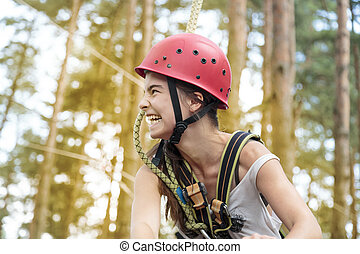 portrait of a laughing teenage girl with helmet