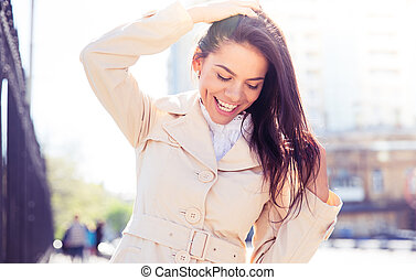 Portrait of a laughing woman outdoors
