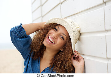 Portrait of a laughing woman wearing hat