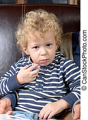 portrait of a little blond boy