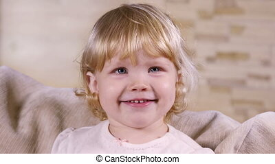 Portrait of a little blond girl indoors - Portrait of a ...